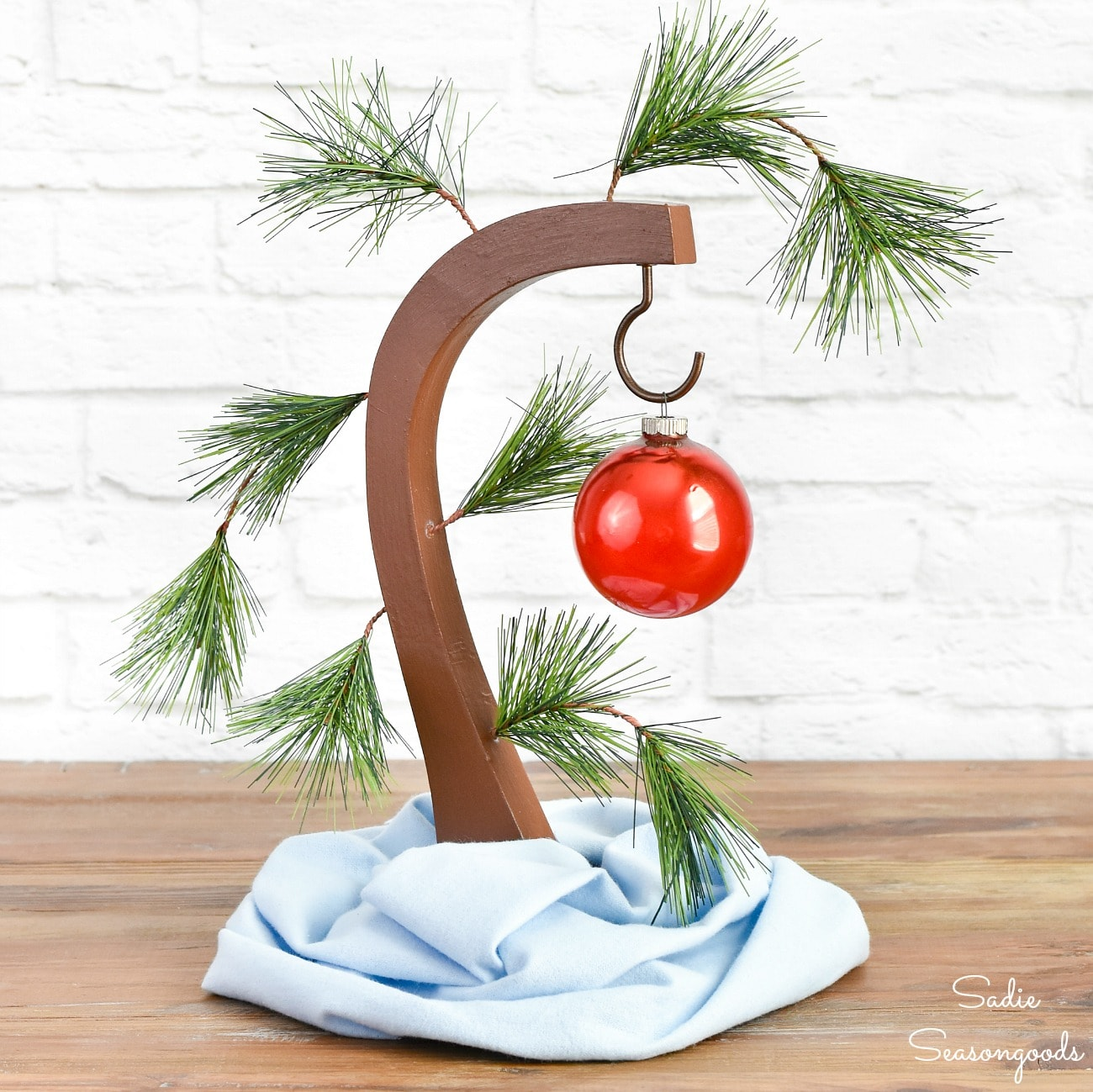 Upcycled Charlie Brown Tree by Sadie Seasongoods, featured in DIY Salvaged Junk Projects 557 on Funky Junk!