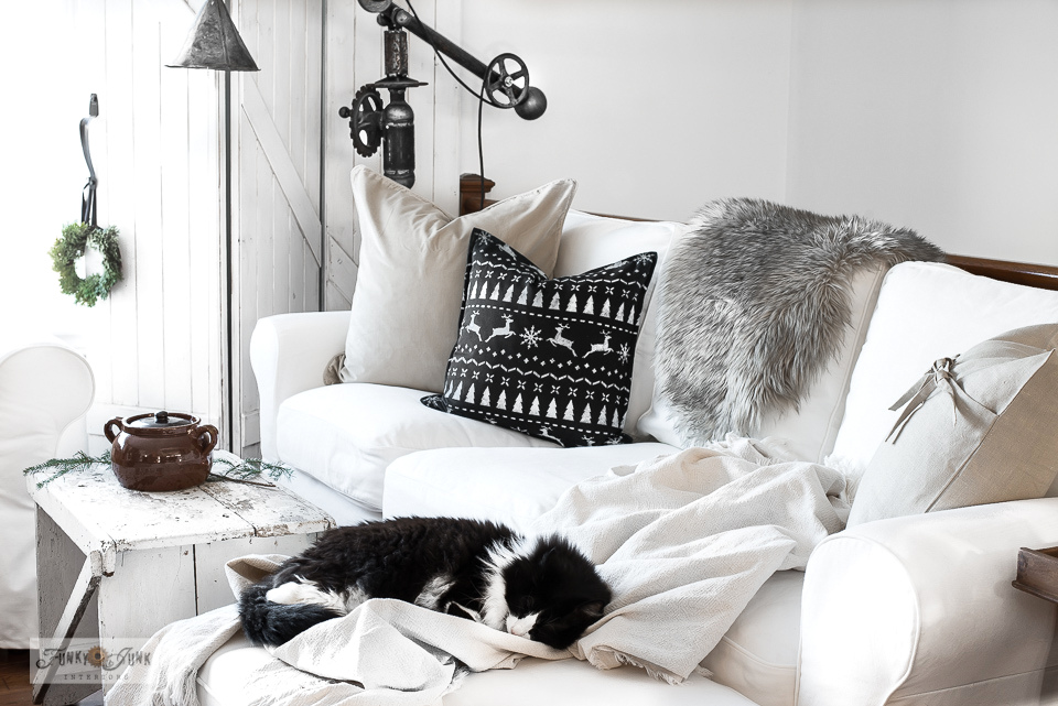 White Ektorp sofas with sweater pillows in Christmas living room home tour - click to learn how to make the pillows!