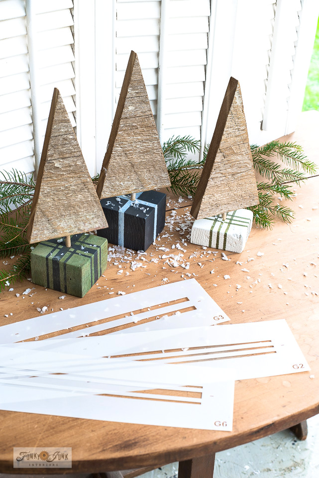 Learn how to create these rustic festive scrap wood Christmas trees in presents using Grain Sack Stripe stencils! Perfect for Christmas decorating! Click to learn how through a full tutorial!