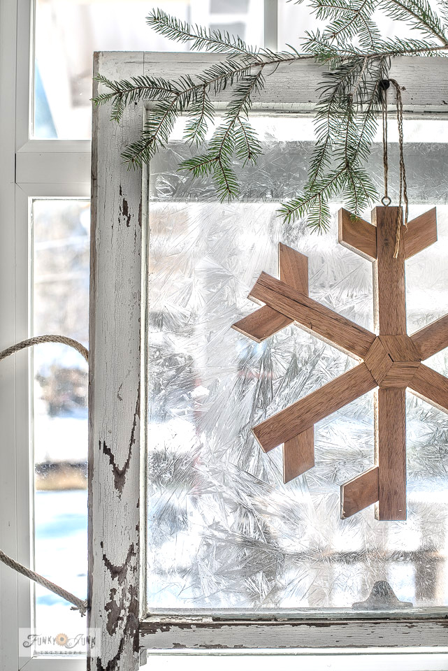 Learn how to add a realistic frosty effect to glass windows! Perfect for Christmas or winter decorating! Click for full instructions and check out more pictures of this vintage window with wooden snowflake in a Christmas kitchen home tour!
