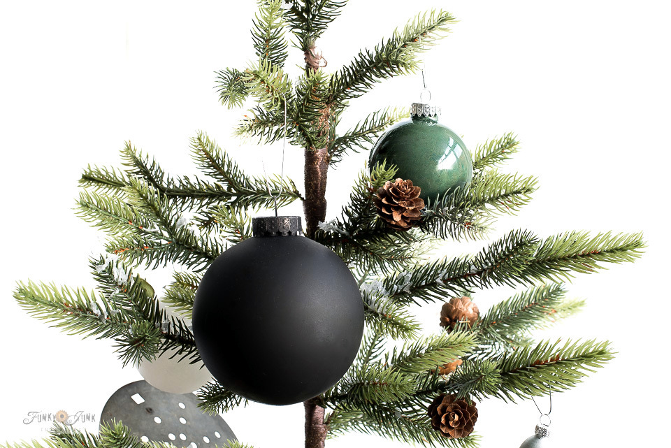 If you've ever wished Christmas ornaments came in different colors, here's 2 ways to paint Christmas ornaments in custom colors of choice! Click to read full tutorial and watch a helpful video of the process!