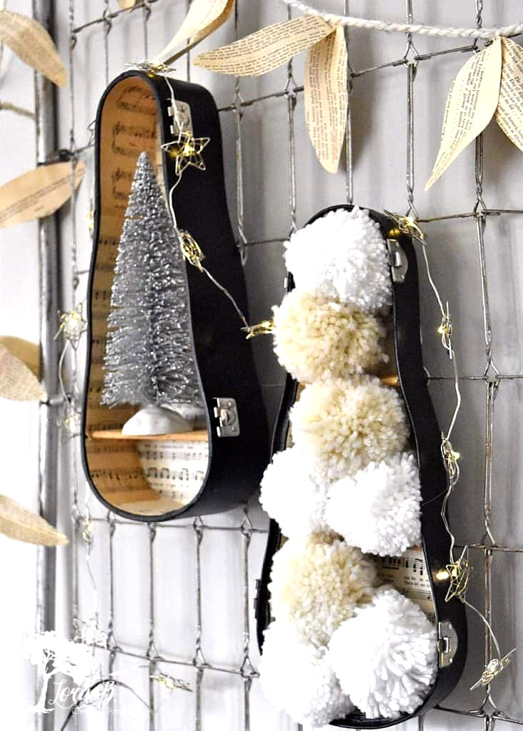 Violin case Christmas decor wall shelves by Lora B, featured on DIY Salvaged Junk Projects 558 on Funky Junk!