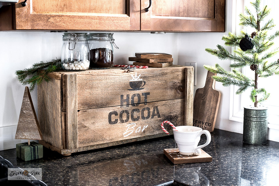 Learn how to build this unique rustic wood hot cocoa bar appliance garage that hides all your coffee equipment! Perfect for Christmas decorating! Click to read full tutorial.