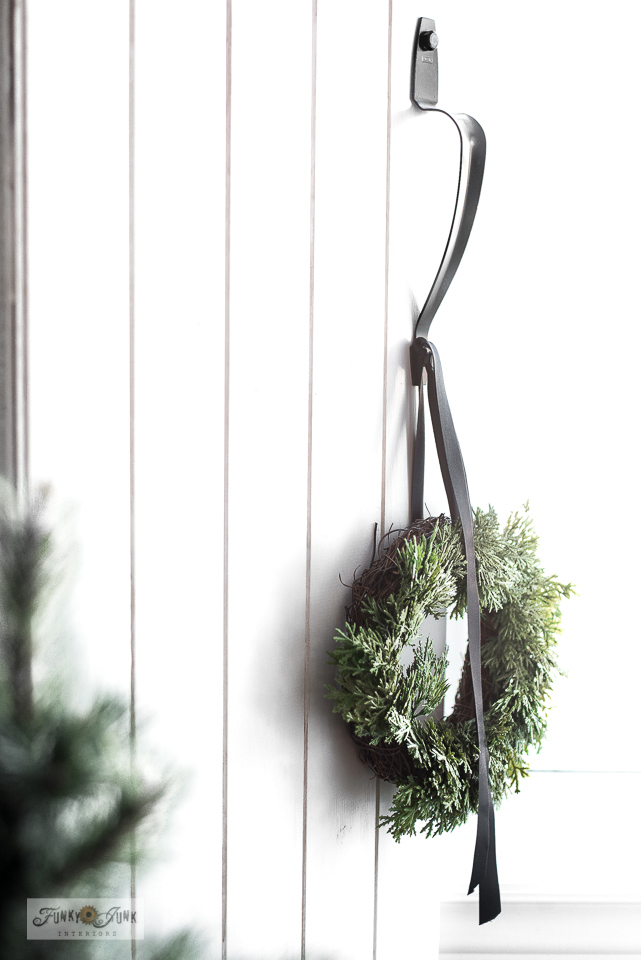 Wreath with black ribbon in Christmas living room home tour.