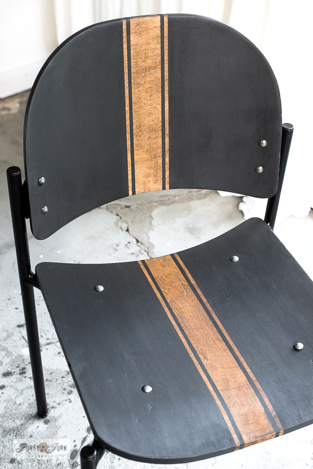 Learn how to create a decadent woodgrain grain sack stripe effect shown on a dramatic vintage wood stackable chair makeover! With Funky Junk's Old Sign Stencils and Fusion Mineral Paint. Click to read full tutorial.