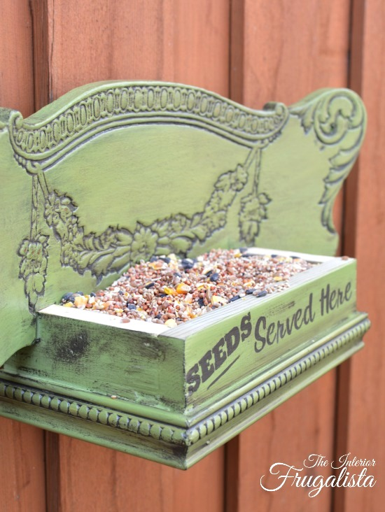 Chair back bird feeder by Interior Frugalista, featured on DIY Salvaged Junk Projects 561 on Funky Junk!