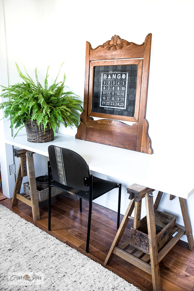 Ikea trestle desk with vintage chair and bulletin board