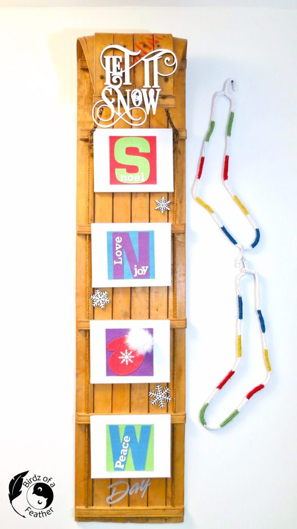 Snow sled sign by Birdz of a Feather, featured on DIY Salvaged Junk Projects 559 on Funky Junk!