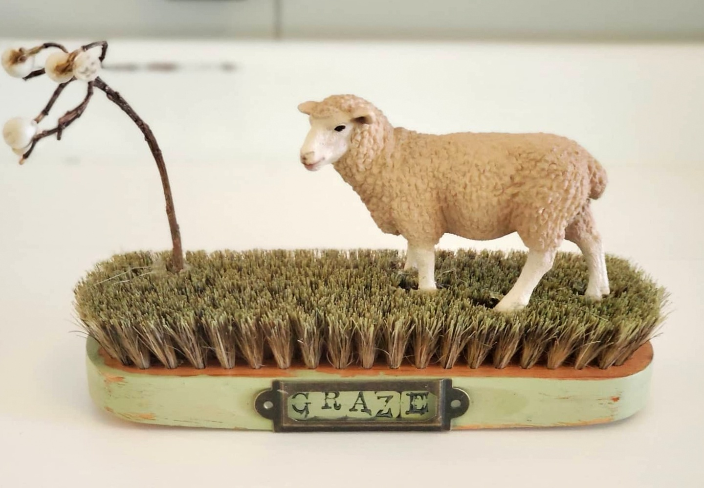 Graze sheep on a brush field vignette by Junky Encores, featured on DIY Salvaged Junk Projects 561 on Funky Junk!