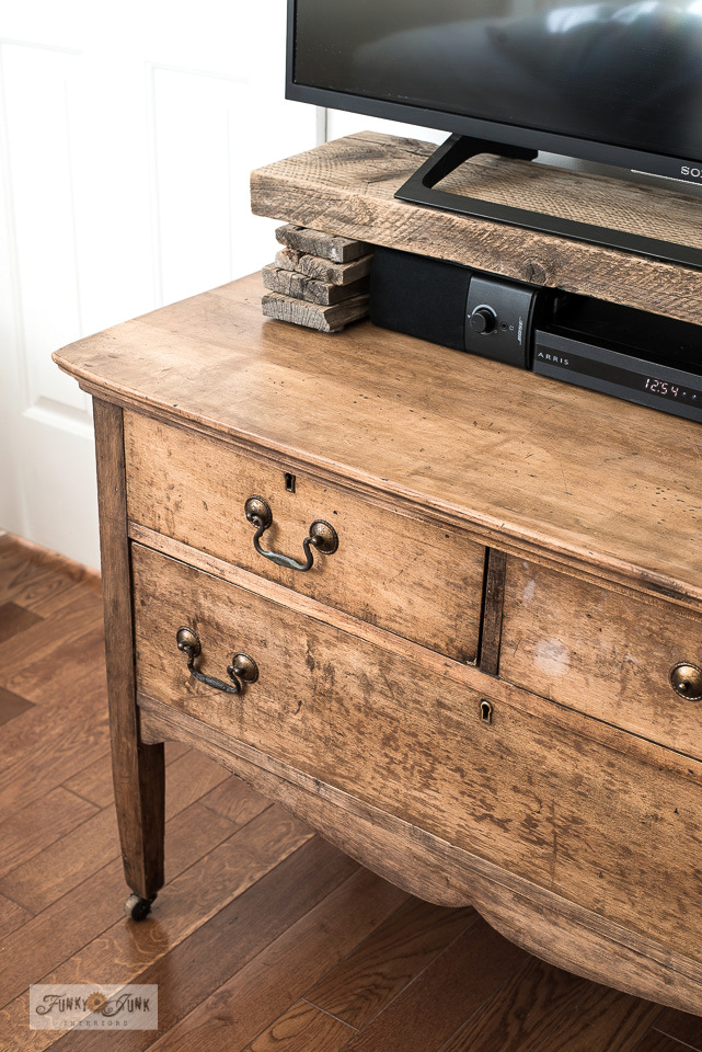 A vintage dresser and reclaimed wood shelf turns into a TV media stand. Click to learn how.