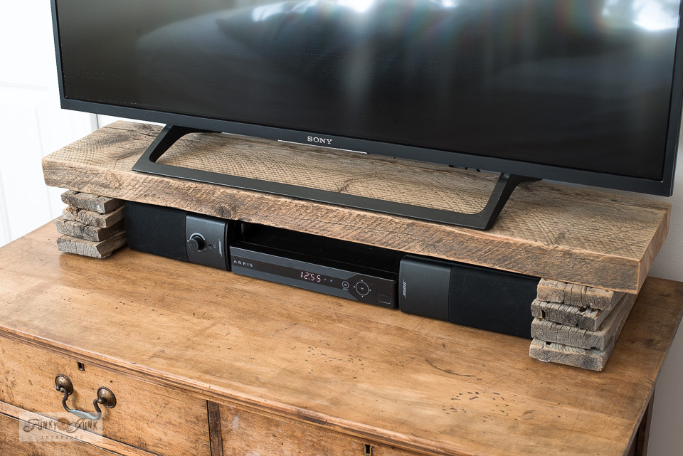 Learn how to build a reclaimed wood riser shelf for a TV media stand. Click to read full tutorial.