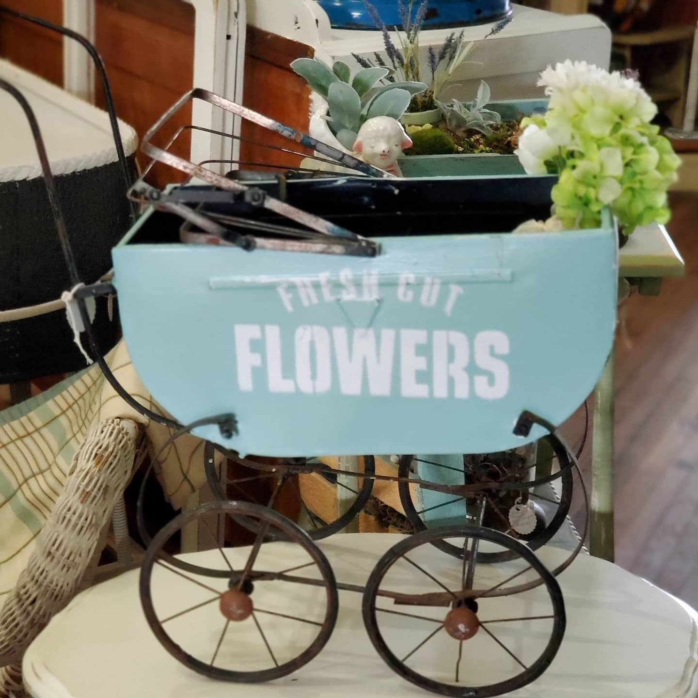 Fresh Cut Flowers vintage buggy by Junky Encores, featured on DIY Salvaged Junk Projects 565 on Funky Junk!