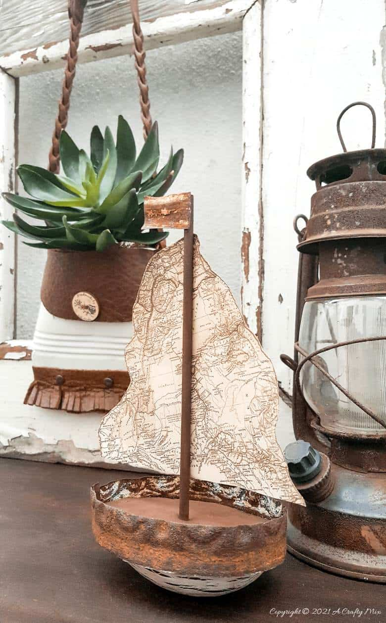 Rustic map and avocado sailboat by A Crafty Mix, featured on DIY Salvaged Junk Projects 566 on Funky Junk!