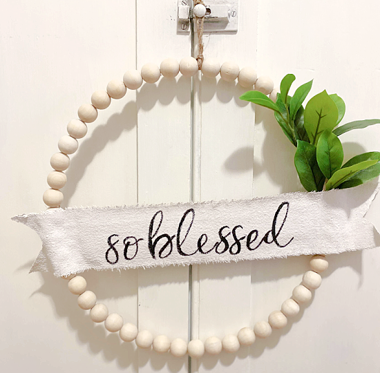 Beaded spring wreath by Homeroad, featured on DIY Salvaged Junk Projects 566 on Funky Junk!