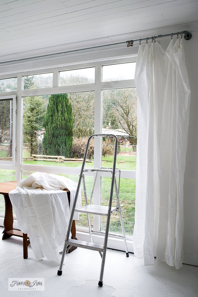 Learn how easy it is to create light and airy sheet curtains on pipe curtain rods as a fabulously affordable window treatment! Click to read full tutorial.