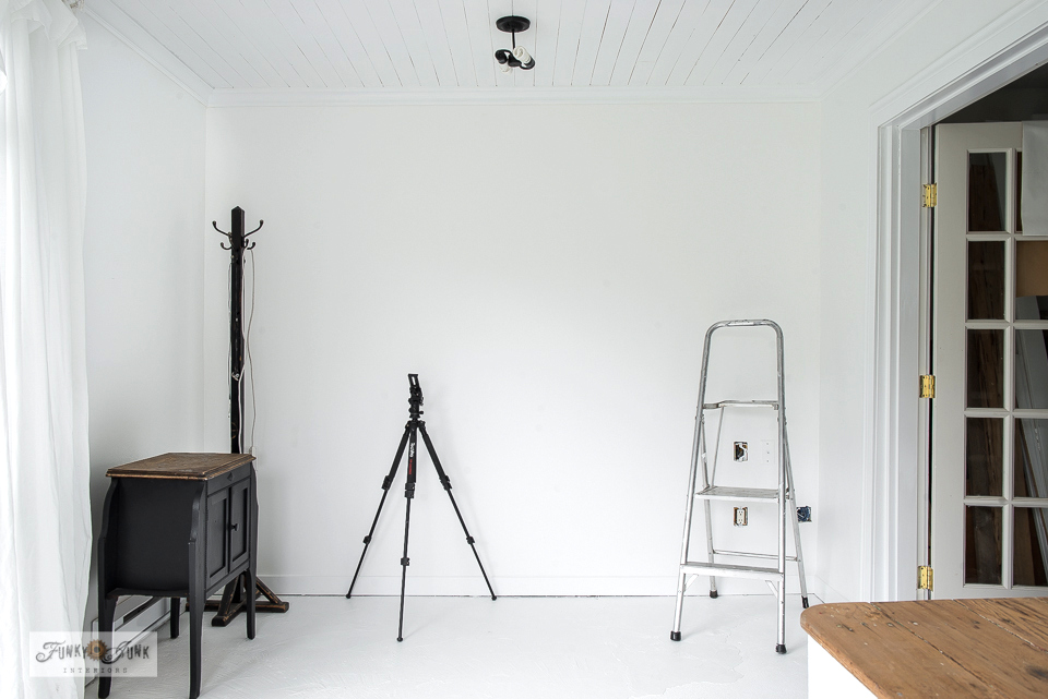 Learn how to paint a concrete floor white to lighten up a room instantly! Such an affordable way to get new floors! Click to read the full tutorial.