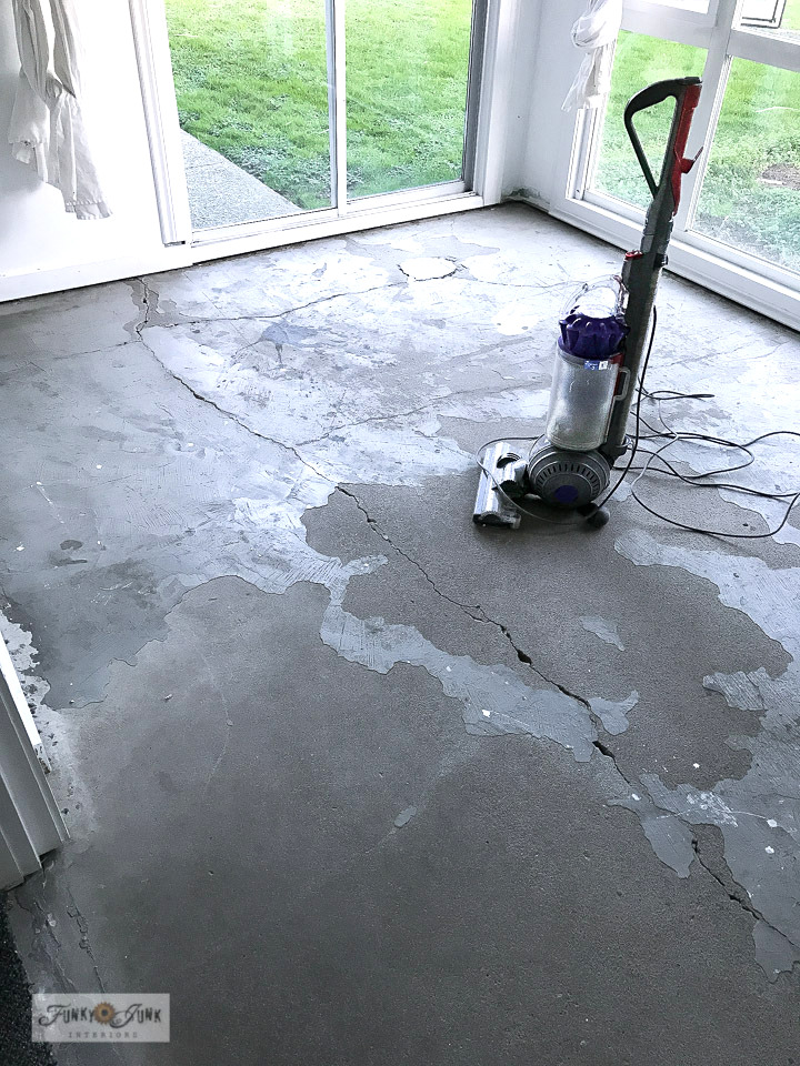 Learn how to turn a dark concrete floor into a beautiful white with just paint! Click to see the dramatic after!