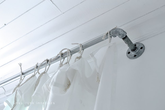 Learn how to build industrial pipe curtain rods with sheet curtains!