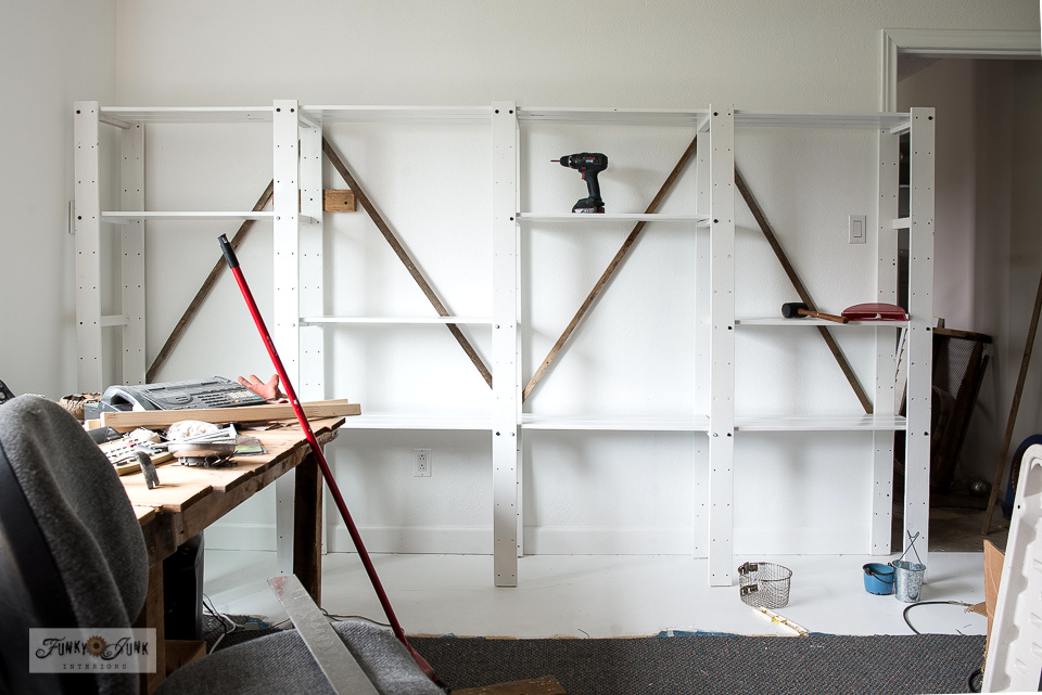 Ikea Gorm white shelving braced with reclaimed wood for a rustic take!