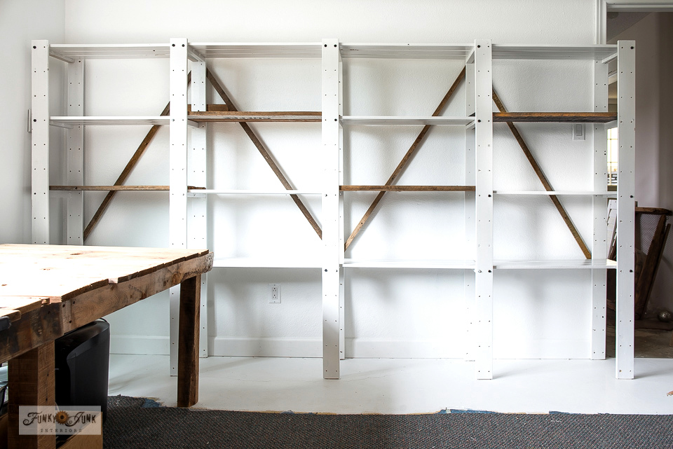 Ikea Gorm white painted shelving gets braced and planked with reclaimed wood for a rustic vibe, ready to store!