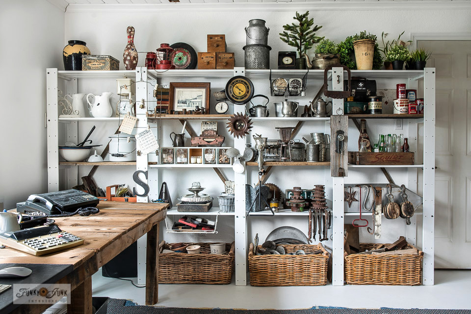 Learn how to hack Ikea shelving with reclaimed wood to create collection storage on white painted shelving with a rustic take! Click to read the full tutorial and take the rusty junk collection tour!