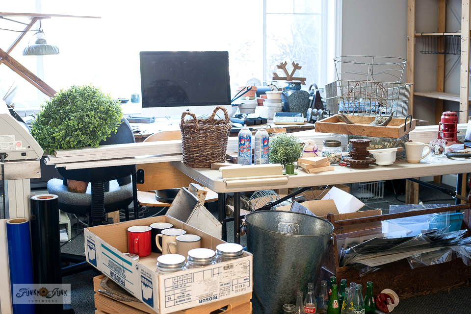 A messy collection of home decor that needs a new home. Let's organize!
