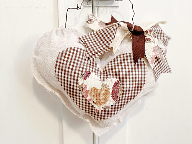 Fabric stuffed hanging heart by Homeroad, featured on DIY Salvaged Junk Projects 563 on Funky Junk!
