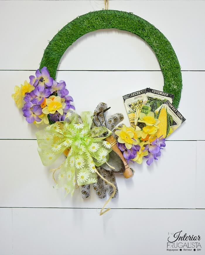 Spring garden-themed wreath by Interior Frugalista, featured on DIY Salvaged Junk Projects 570 on Funky Junk!