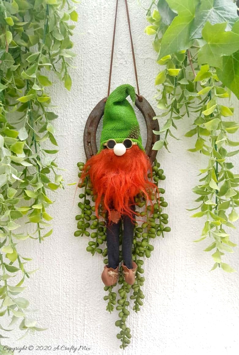 DIY Leprechaun on a Horseshoe by A Crafty Mix, featured on DIY Salvaged Junk Projects 568 on Funky Junk!