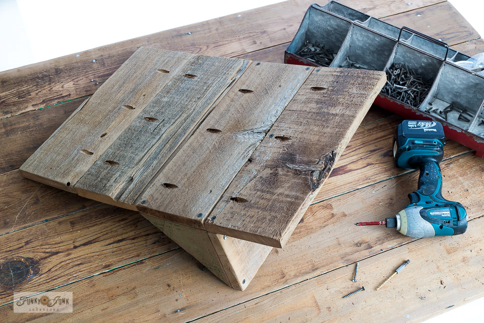 Learn how to use a Kreg Jig to attach reclaimed wood planks. Click to full tutorial including a helpful video!