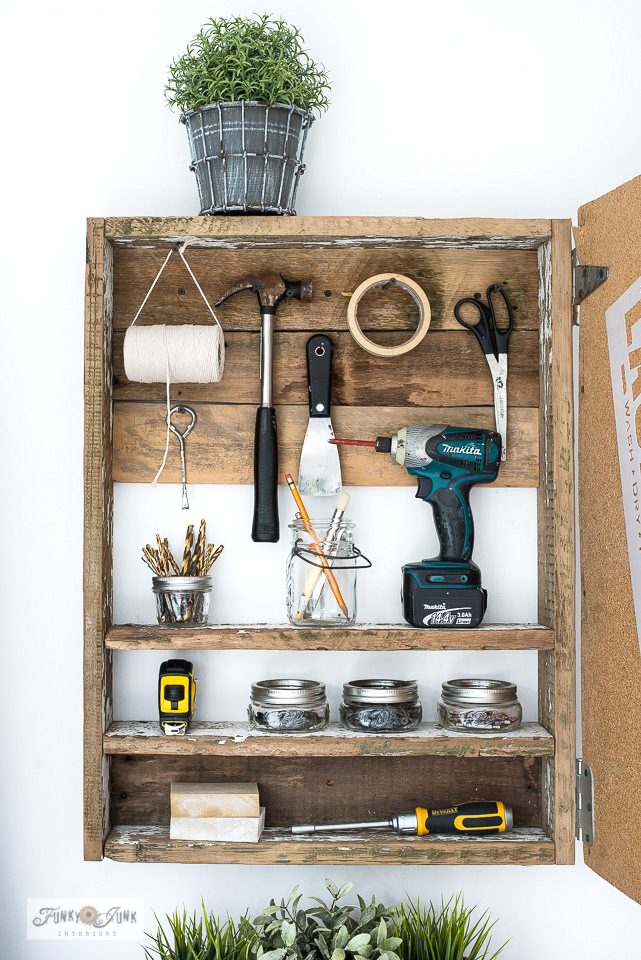 Learn how to build a rustically charming reclaimed wood Organic Coffee storage cabinet with a hidden bulletin board! Stylish storage that hides all the clutter! Made with Funky Junk's Old Sign Stencils. Click to read full tutorial.