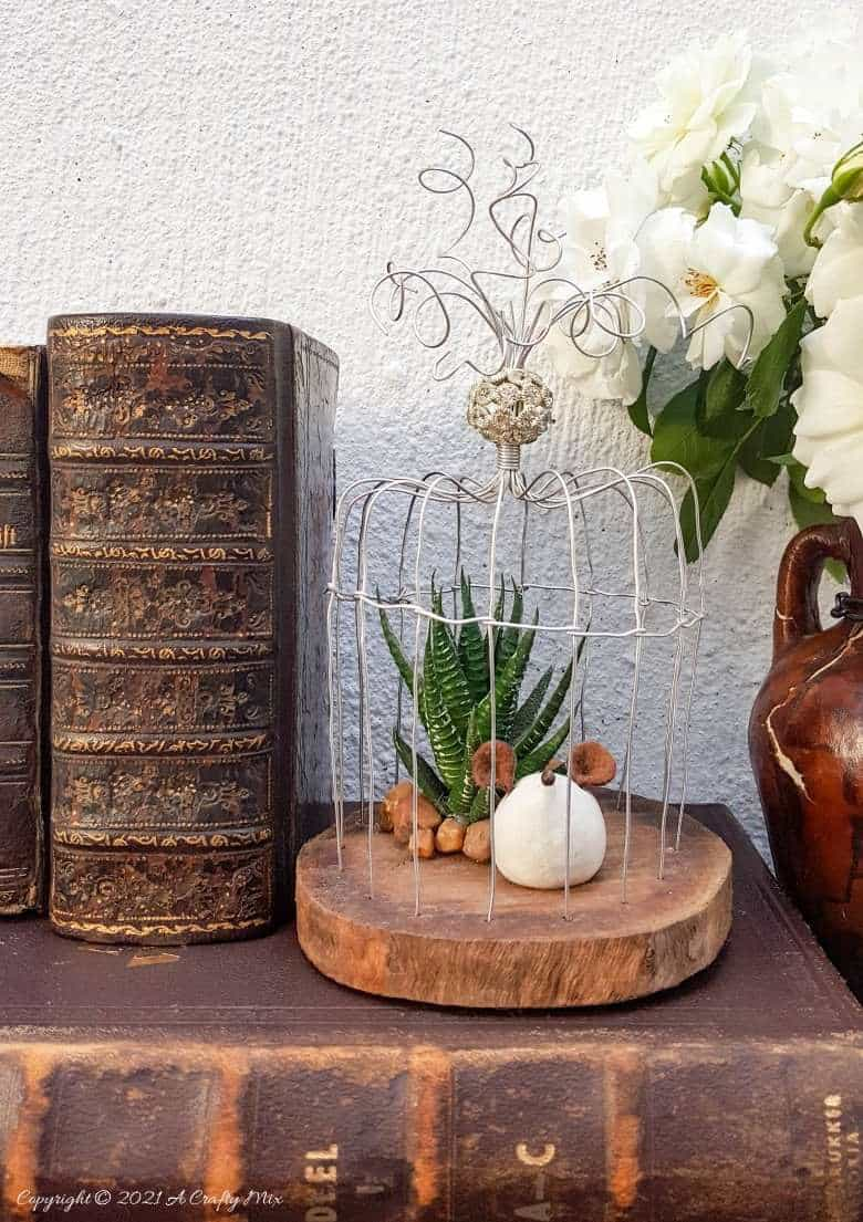 Art deco wire and wood birdcage by A Crafty Mix, featured on DIY Salvaged Junk Projects 570 on Funky Junk!