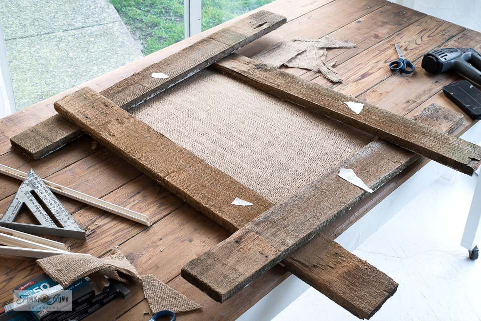 How to frame a bulletin board with reclaimed wood and a Kreg Jig to create a coffee bean sack bulletin board sign. Click to read full tutorial along with helpful video!