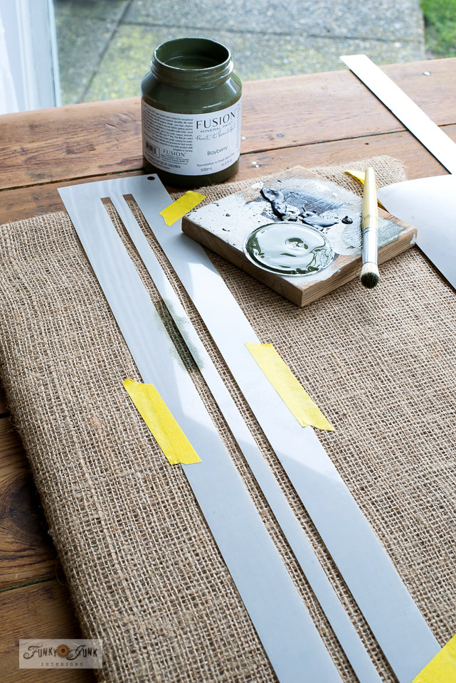 Learn how to achieve authentic green grain sack stripes stenciled onto a burlap bean bag coffee sign with Funky Junk's Old Sign Stencils and Fusion Mineral Paint's Bayberry!