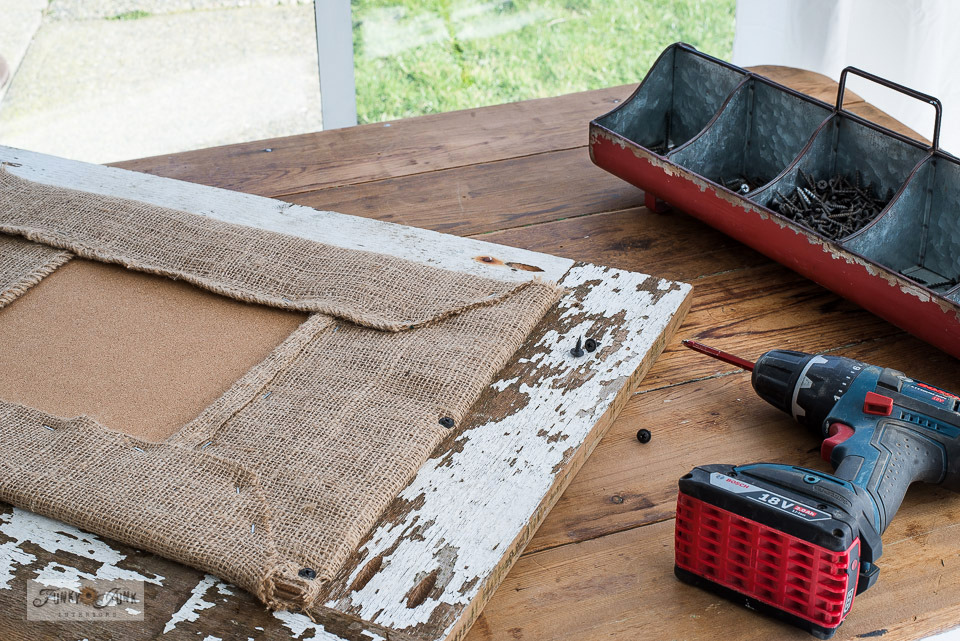 Learn how to frame a rustic coffee bean sack bulletin board sign with reclaimed wood. Click to read full tutorial.