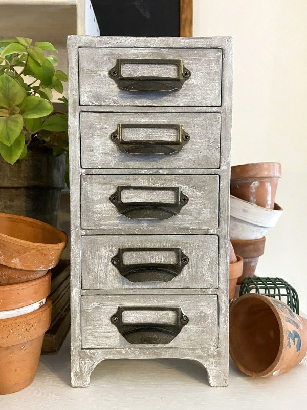 Concrete apothecary makeover by Wisconsin Magpie, featured on DIY Salvaged Junk Projects 568 on Funky Junk!