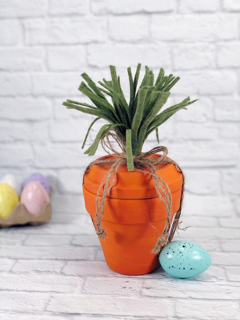 Clay pot carrot Easter basket by Creatively Beth, featured on DIY Salvaged Junk Projects 571 on Funky Junk!