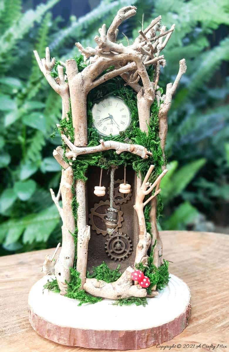 Fairy grandfather clock by A Crafty Mix, featured on DIY Salvaged Junk Projects 573 on Funky Junk!