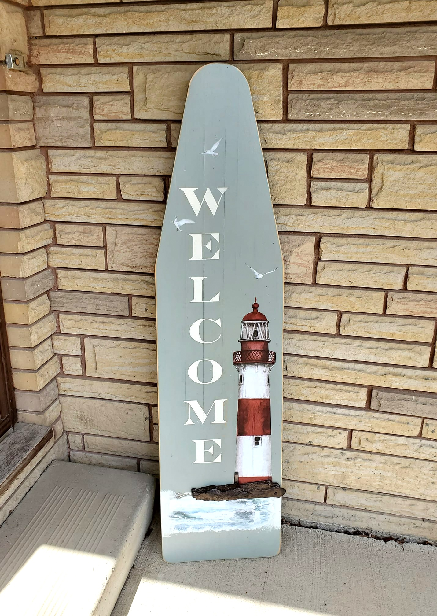 Ironing board welcome sign by Junky Encores on Facebook, featured on DIY Salvaged Junk Projects 573 on Funky Junk!