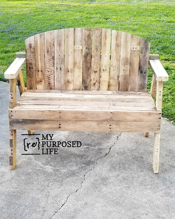 Pallet outdoor loveseat by My Repurposed Life, featured on DIY Salvaged Junk Projects 572 on Funky Junk!