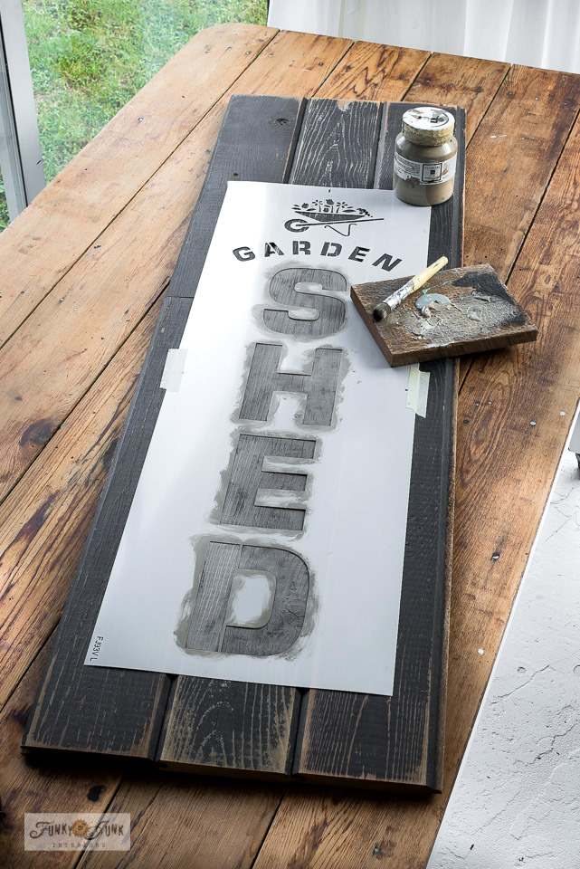 Learn how to create this charming vertical rustic Garden Shed sign with a rusty rake head! With easy flowerbed edging using reclaimed wood! Two pretty and easy ways to enhance any plain garden shed. With Funky Junk's Old Sign Stencils. Click to read full tutorial.