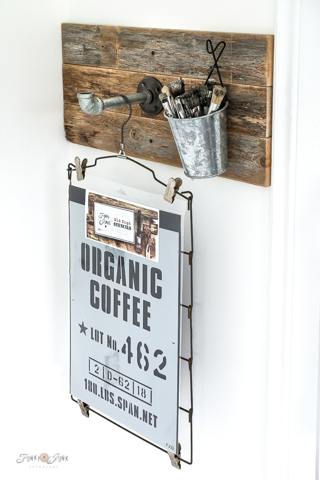 Wood and pipe stencil storage hooks by Funky Junk Interiors