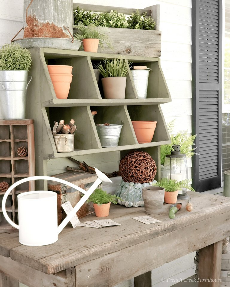 Spring potting bench decor by French Creek Farmhouse, featured on New Upcycled Projects to Make 581 on Funky Junk!