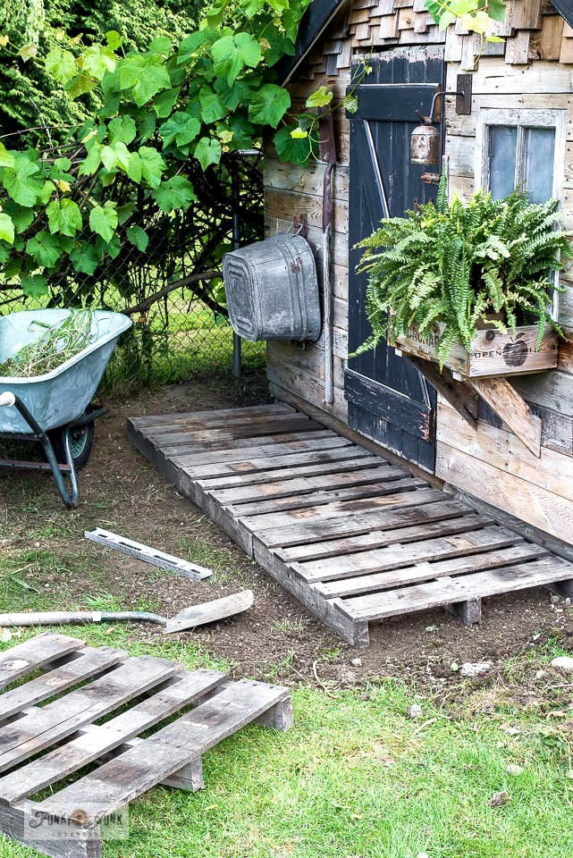 Learn how to make a quick and easy pallet porch for a garden shed! Rustically charming as a front step or displaying planters and flower pots! Click to read full tutorial.