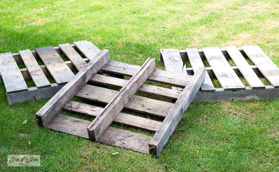 See how these pallets became the perfect little rustic front porch for a garden shed!