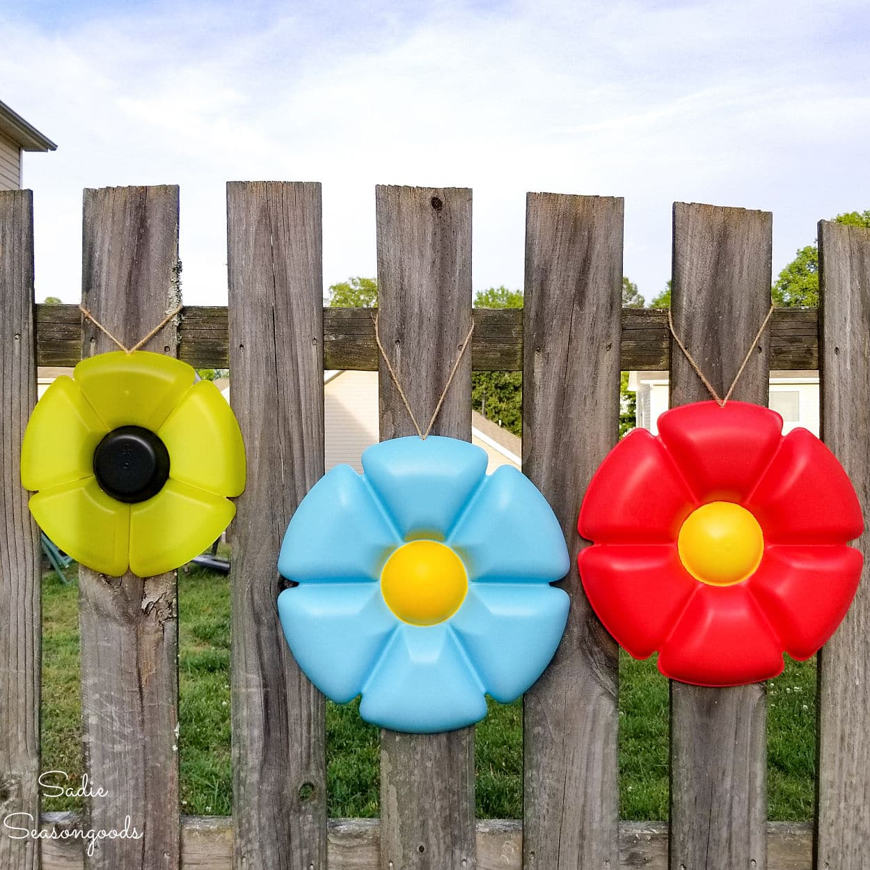 Plastic tray garden flower art by Sadie Seasongoods, featured on New Upcycled Projects to Make 583 on Funky Junk!