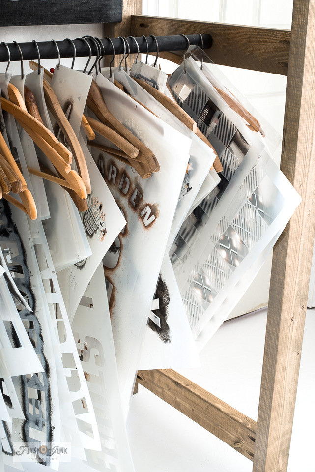 Learn how to organize your stencils rustic-style with this easy-build 2x4 wood stencil storage rack! Includes tips on staining wood to look reclaimed! Visit full tutorial HERE
