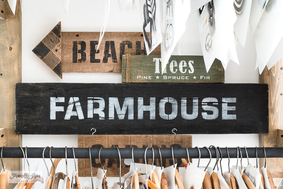 Display reclaimed wood signs inside this clever and rustic stencil storage rack made from 2x4s!