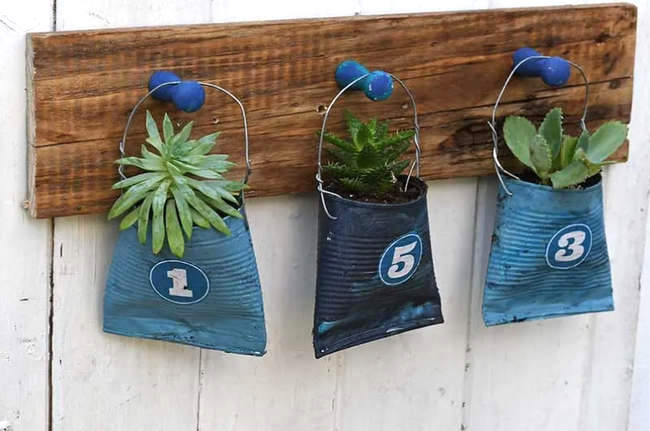 Soda can hanging planters by Pillar Box Blue, featured on New Upcycled Projects to Make 589 on Funky Junk!