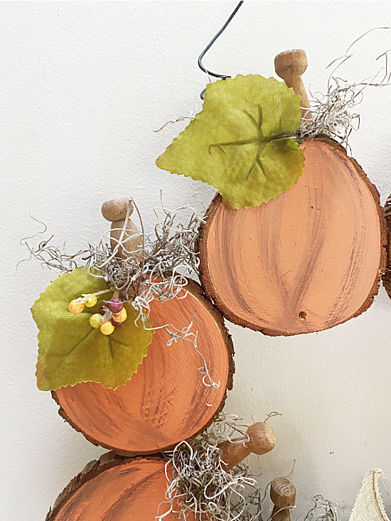 Wood slice fall pumpkin wreath by Homeroad, featured on New Upcycled Projects to Make 594